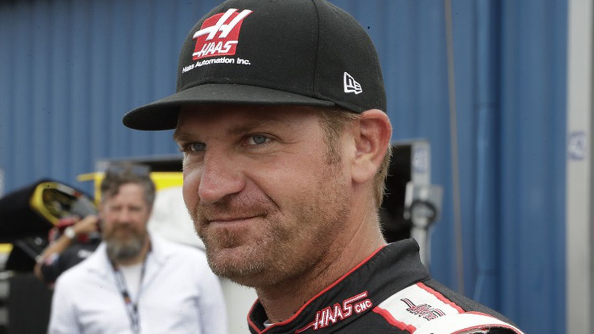 Clint Bowyer walks in the garage area before a practice session, Saturday, June 17, 2017, for the NASCAR Sprint Cup series auto race in Brooklyn, Mich. (AP Photo/Carlos Osorio)