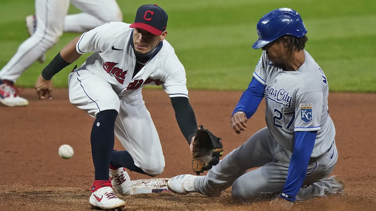 Cleveland Indians' Cesar Hernandez, left, waits for the ball as Kansas City Royals' Adalberto Mondesi slides safely into second base on a steal in the fifth inning of a baseball game, Monday, Sept. 7, 2020, in Cleveland. (AP Photo/Tony Dejak)