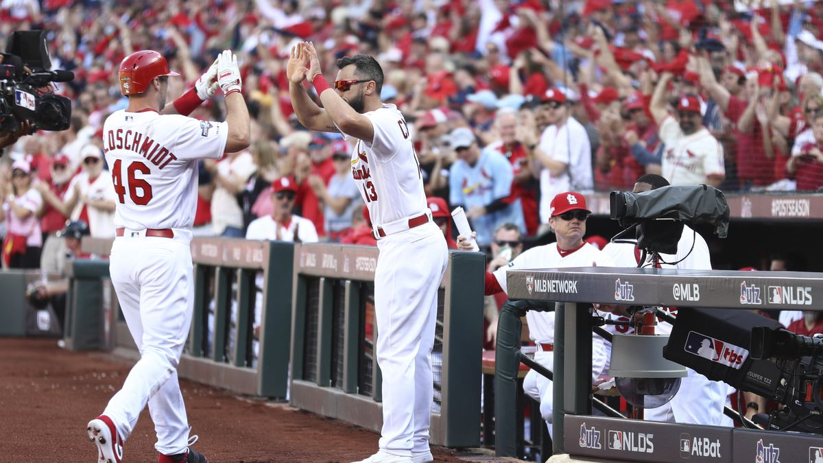 St. Louis Cardinals' Paul Goldschmidt (46) celebrates with Matt Carpenter (13) after hitting a...