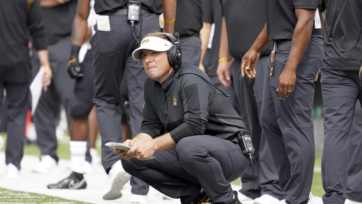Missouri head coach Eliah Drinkwitz looks on from the sideline during the first half of an NCAA...