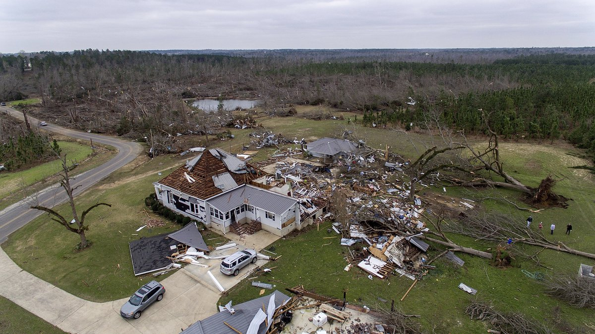 Debris litters a property after a home was damaged by a tornado a day earlier in Beauregard,...