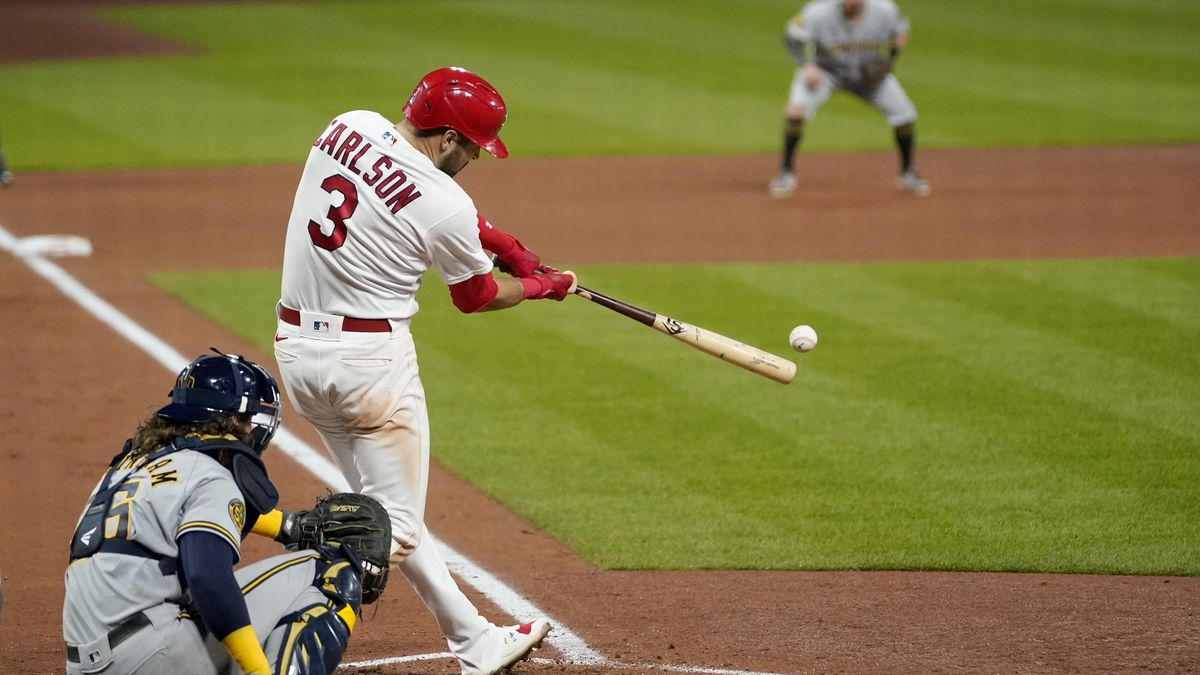 St. Louis Cardinals' Dylan Carlson (3) hits a two-run double during the fifth inning in the second game of a baseball doubleheader against the Milwaukee Brewers Friday, Sept. 25, 2020, in St. Louis. (AP Photo/Jeff Roberson)