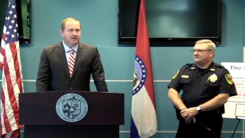 Missouri Attorney General Eric Schmitt stands next to Springfield Police Chief Paul Williams.