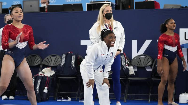 Gymnasts from the United States, Simone Biles, centre, Jordan Chiles , right, and Sunisa Lee...