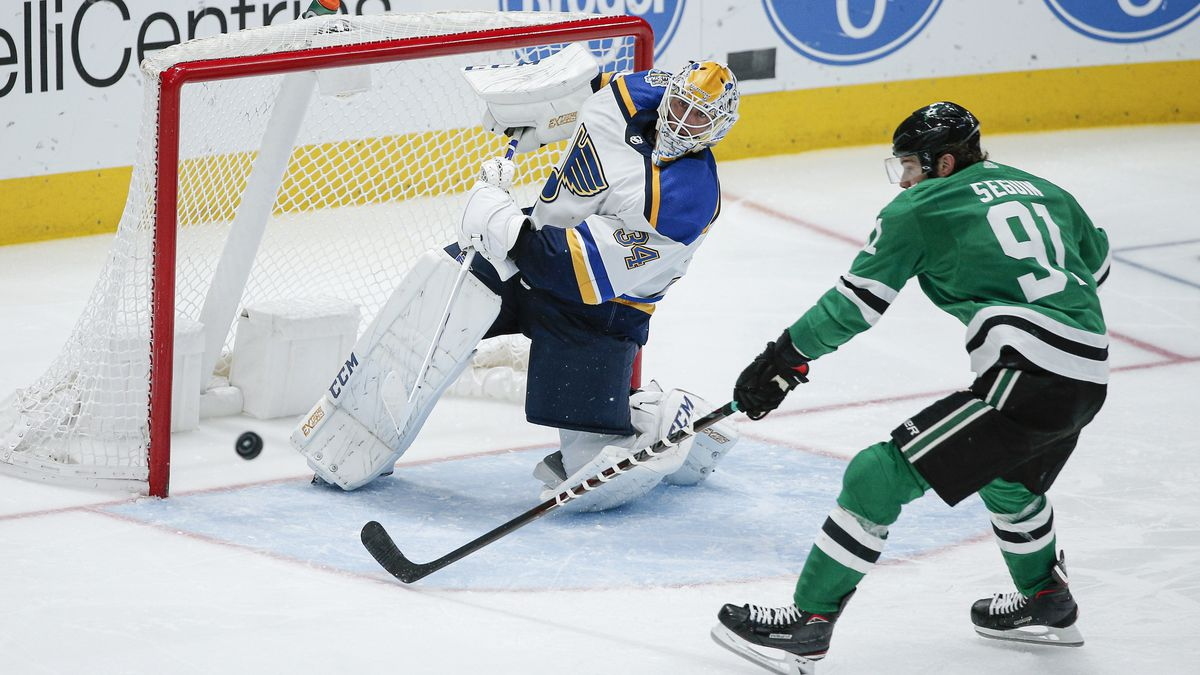 St. Louis Blues goaltender Jake Allen (34) clears the puck in front of Dallas Stars forward Tyler Seguin (91) during the third period of an NHL hockey game Friday, Nov. 29, 2019, in Dallas. St. Louis won 3-1. (AP Photo/Brandon Wade)