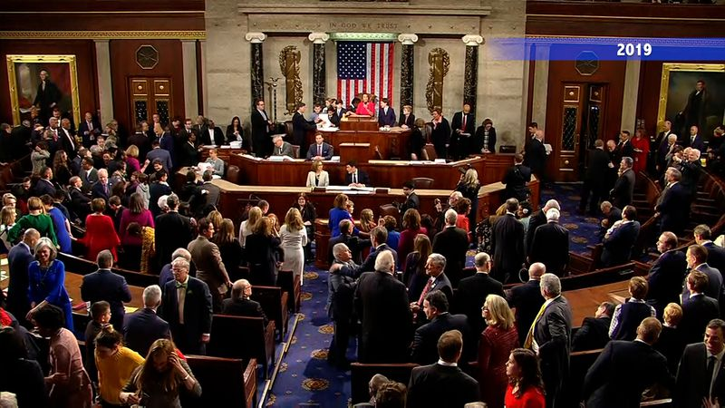 File: Members of the House of Representatives are sworn in to Congress in January 2019.