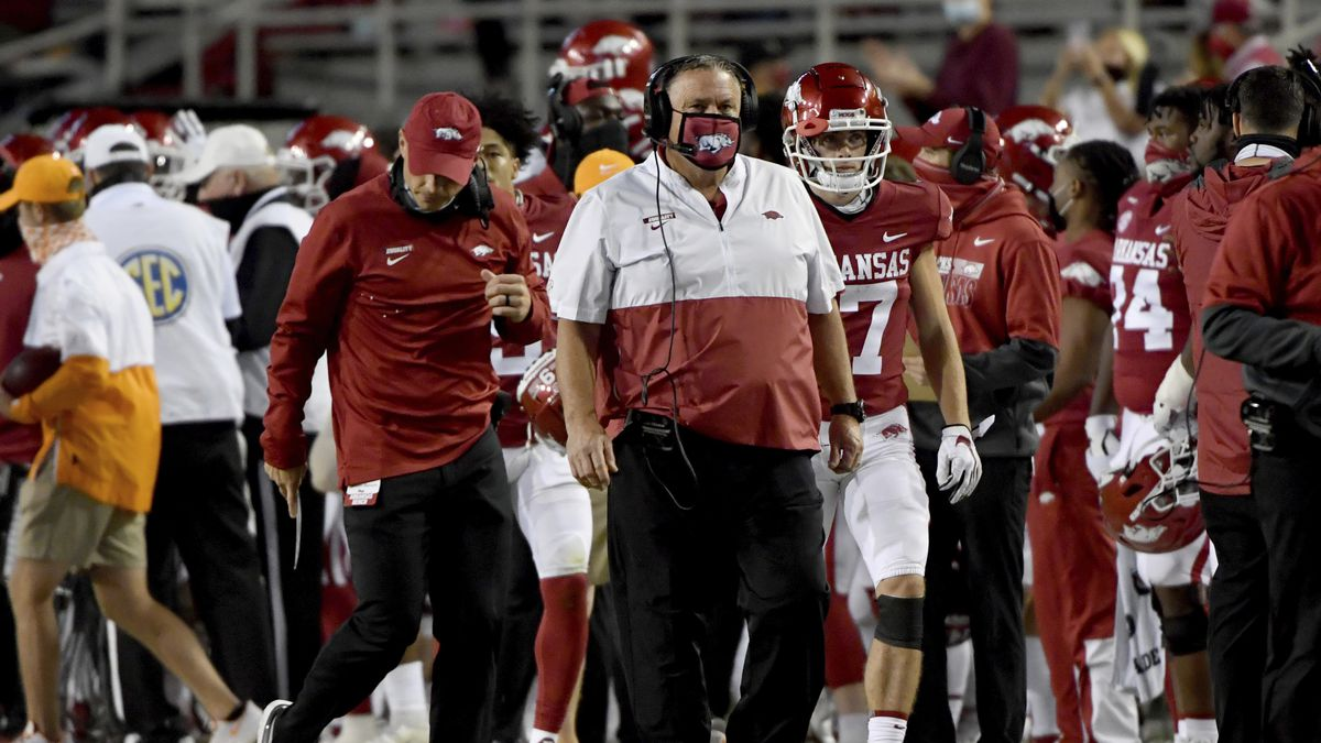 Arkansas coach Sam Pittman walks the sideline during the first half of the team's NCAA college...