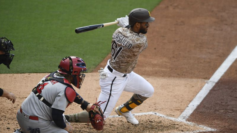San Diego Padres' Ivan Castillo (61) hits an RBI single during the fourth inning of a baseball...