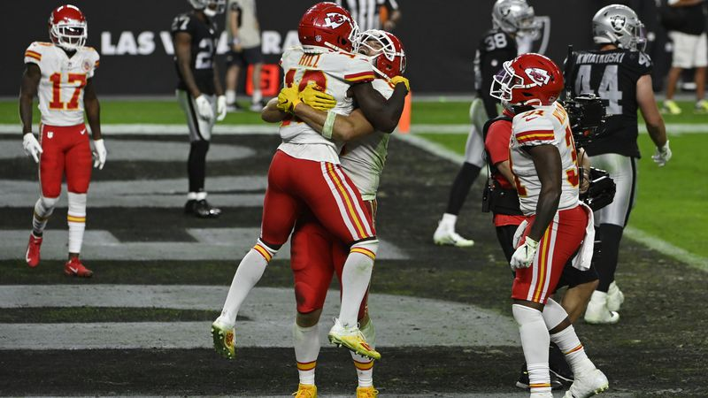 Kansas City Chiefs tight end Travis Kelce embraces wide receiver Tyreek Hill (10) after Kelce...