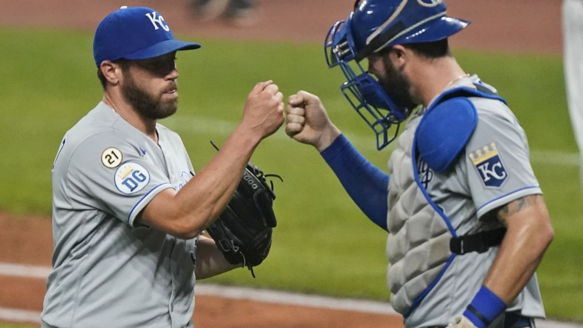 Kansas City Royals relief pitcher Greg Holland, left, is congratulated by catcher Cam Gallagher after the Royals defeated the Cleveland Indians 3-0 in a baseball game Wednesday, Sept. 9, 2020, in Cleveland. (AP Photo/Tony Dejak)
