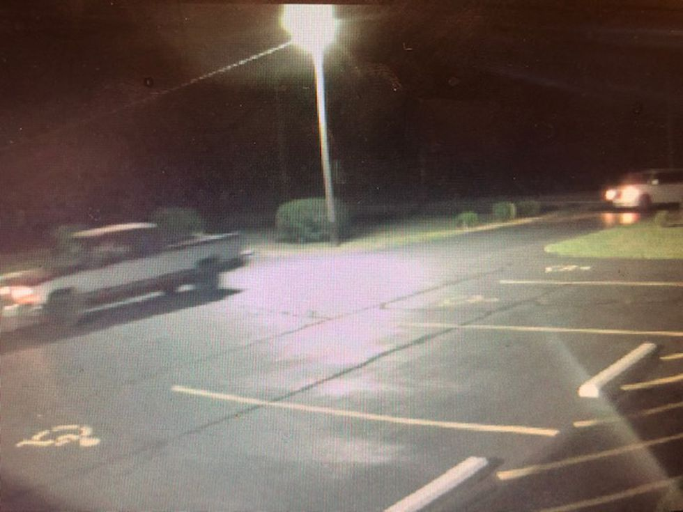 The thieves used an older model gray and maroon pickup and a white minivan.