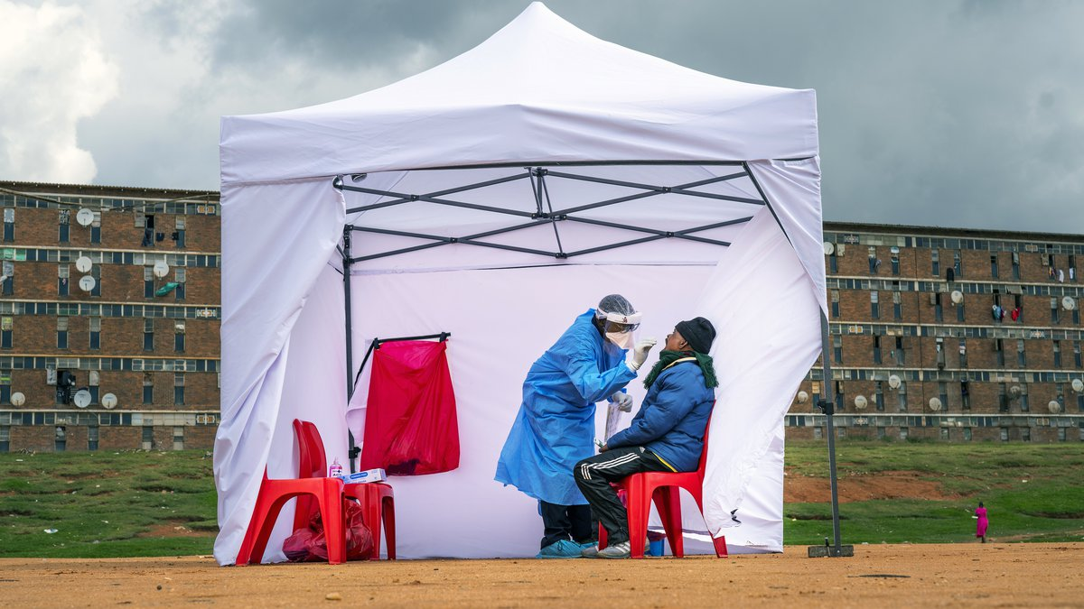 FILE - In this April 29 2020, file photo, a resident from the Alexandra township gets tested...