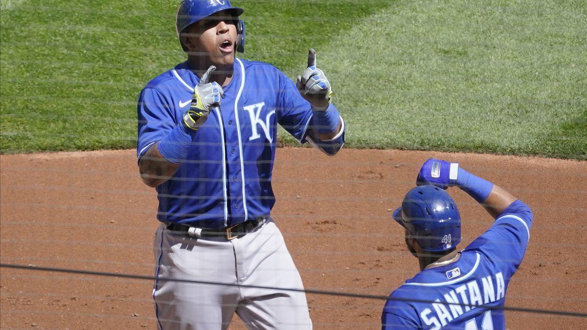 Kansas City Royals Salvador Perez, left, and Carlos Santana celebrate a two-run home run by...