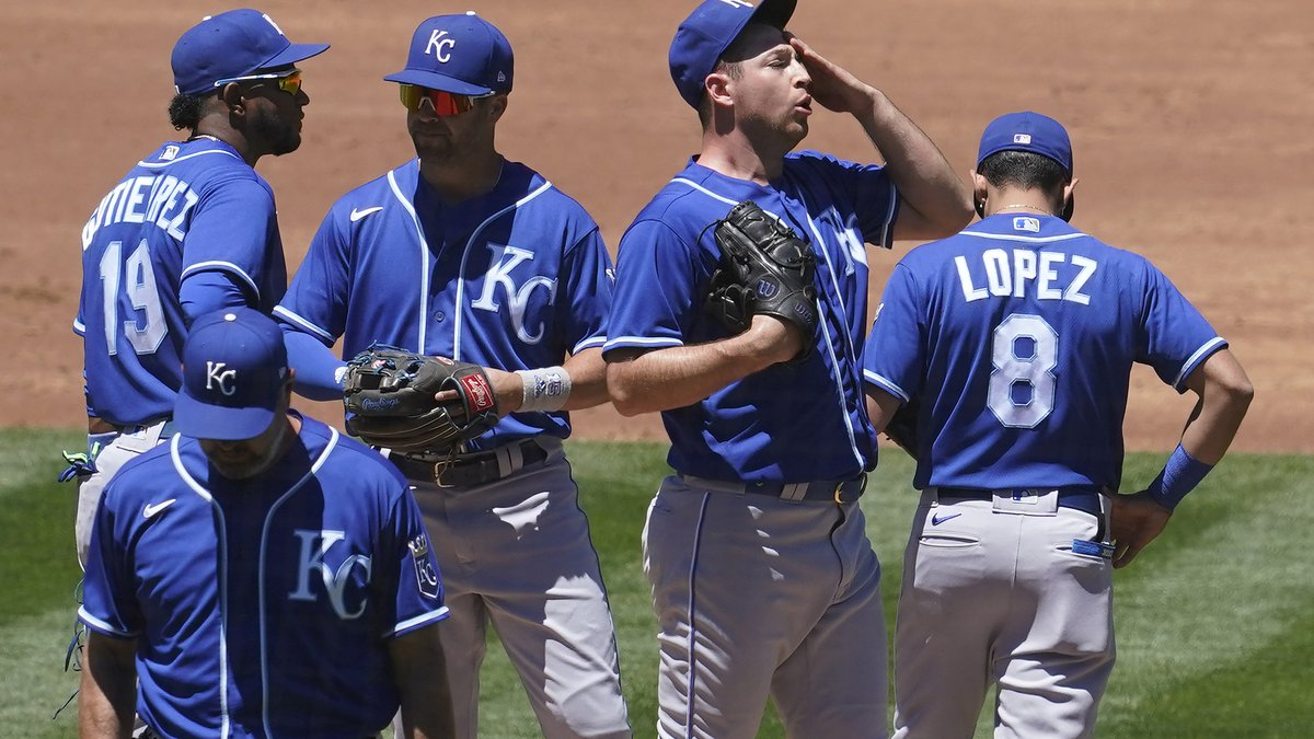 Kansas City Royals pitcher Kris Bubic, middle right, reacts on the mound during the second...