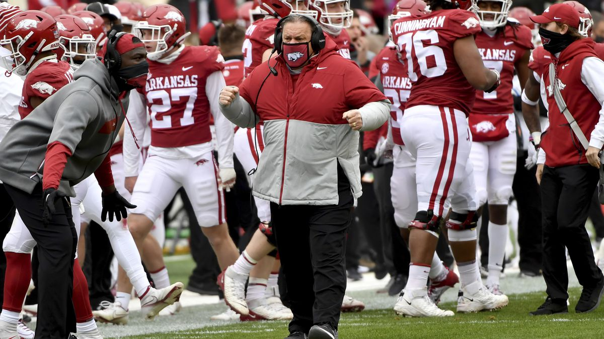 Arkansas coach Sam Pittman, center, reacts after a big play against Alabama during the first...