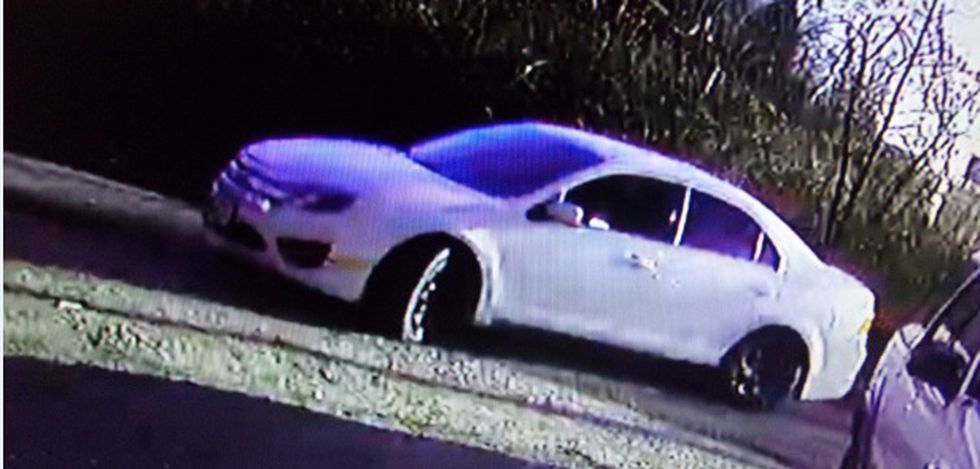 The group arrived and left the home in a white Ford Fusion with black spray-painted wheels.