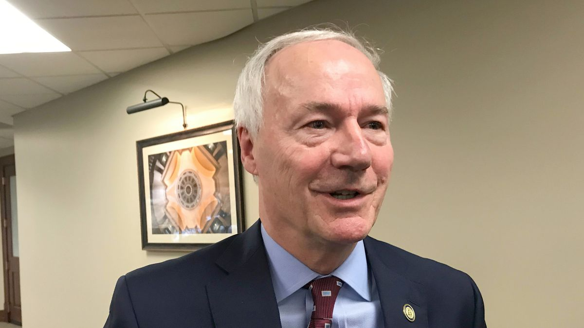 FILE - In this Jan. 13, 2020, file photo, Arkansas Gov. Asa Hutchinson speaks to reporters in...