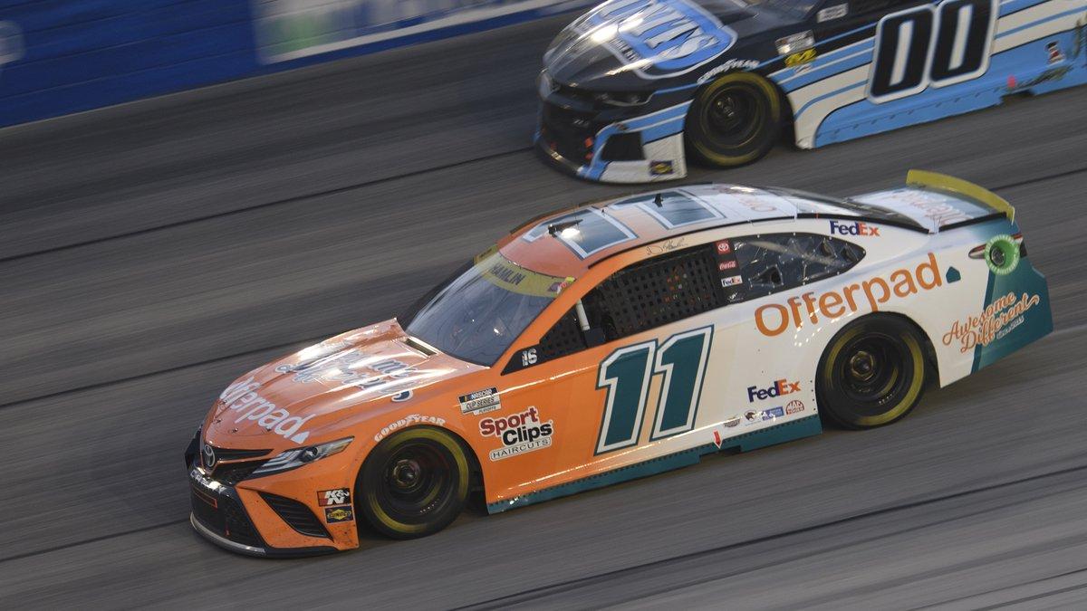 Denny Hamlin (11) races along with Quin Houff (00) in a NASCAR Cup Series auto race Sunday,...