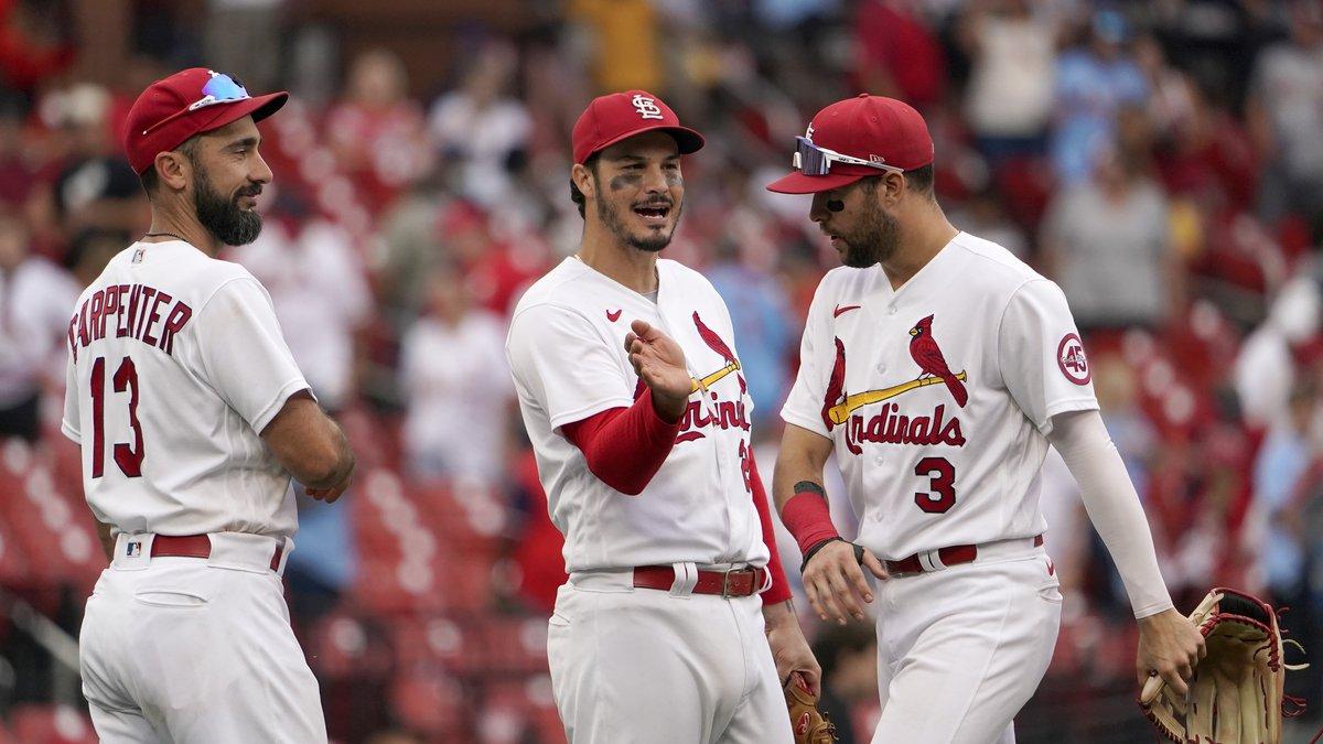 St. Louis Cardinals' Matt Carpenter, left, Nolan Arenado and Dylan Carlson (3) celebrate...