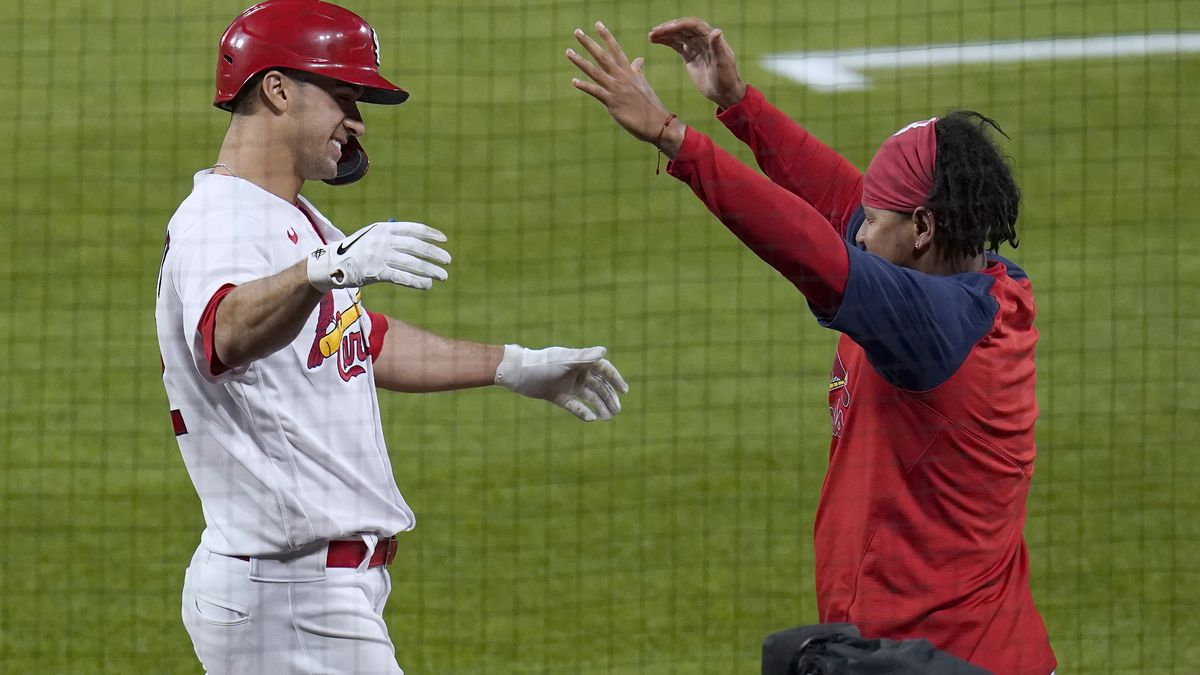 St. Louis Cardinals' Jack Flaherty, left, gets a hug from teammate Carlos Martinez after...