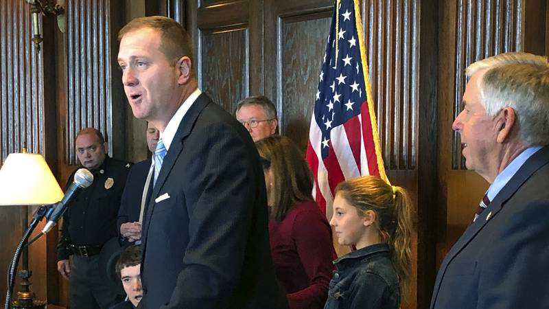 Missouri Treasurer Eric Schmitt speaks to reporters after being announced as the next attorney...