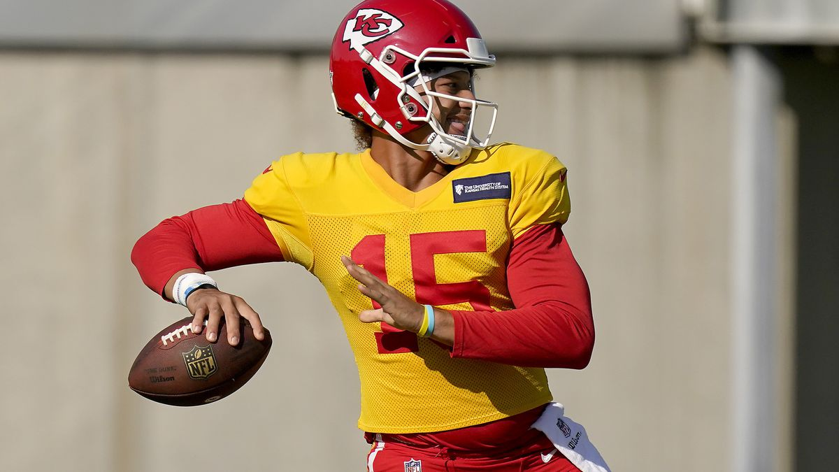 FILE - Kansas City Chiefs quarterback Patrick Mahomes throws a pass during NFL football training camp Friday, Aug. 21, 2020, in Kansas City, Mo. It has been a mere eight months since Patrick Mahomes led Kansas City from a 24-0 hole to beat Deshaun Watson and the Houston Texans in the divisional round of the playoffs, a brutally efficient comeback that ultimately propelled the Chiefs to their first Super Bowl title in 50 years. A whole lot has changed, though. (AP Photo/Charlie Riedel, File)