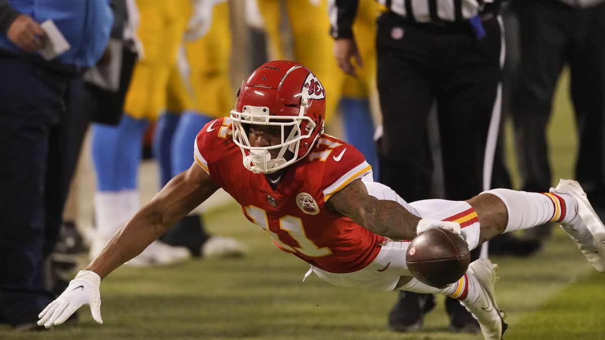 Kansas City Chiefs wide receiver Demarcus Robinson dives for extra yardage during the second...
