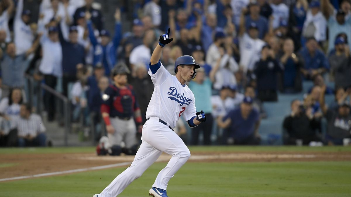 FILE - In this Oct. 28, 2018, file photo, Los Angeles Dodgers' David Freese celebrates after his home run against the Boston Red Sox during the first inning in Game 5 of the World Series baseball game in Los Angeles. Freese is retiring after a 10-year career that included a World Series title in 2011 with the St. Louis Cardinals when he was MVP. The 36-year-old infielder made the announcement Saturday, Oct. 12, 2019, on his verified Twitter account. (AP Photo/Mark J. Terrill, File)