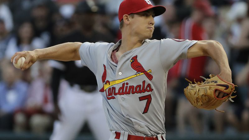 St. Louis Cardinals starting pitcher Luke Weaver throws to a Chicago White Sox batter during...