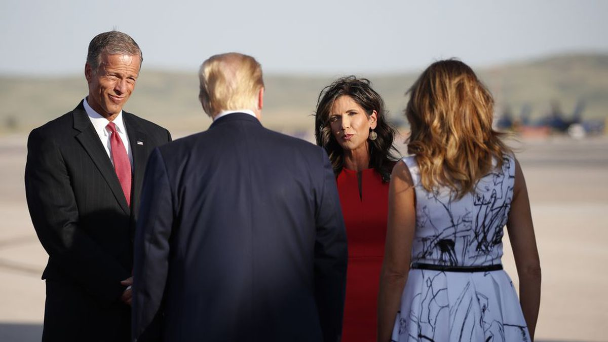 Sen. John Thune, R-S.D., and Gov. Kristi Noem greet President Donald Trump and first Lady Melania Trump upon arrival at Ellsworth Air Force Base, Friday, July 3, 2020, in Rapid City, S.D. Trump is en route to Mount Rushmore National Memorial.(AP Photo/Alex Brandon)