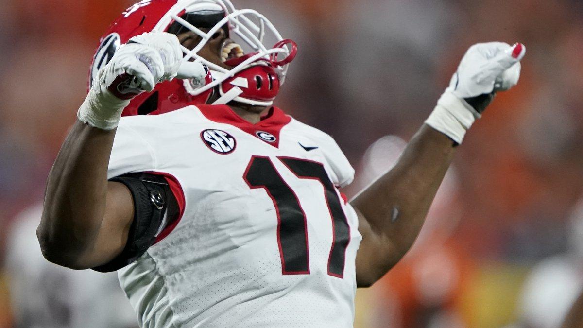 Georgia linebacker Nakobe Dean celebrates after sacking Clemson quarterback D.J. Uiagalelei...