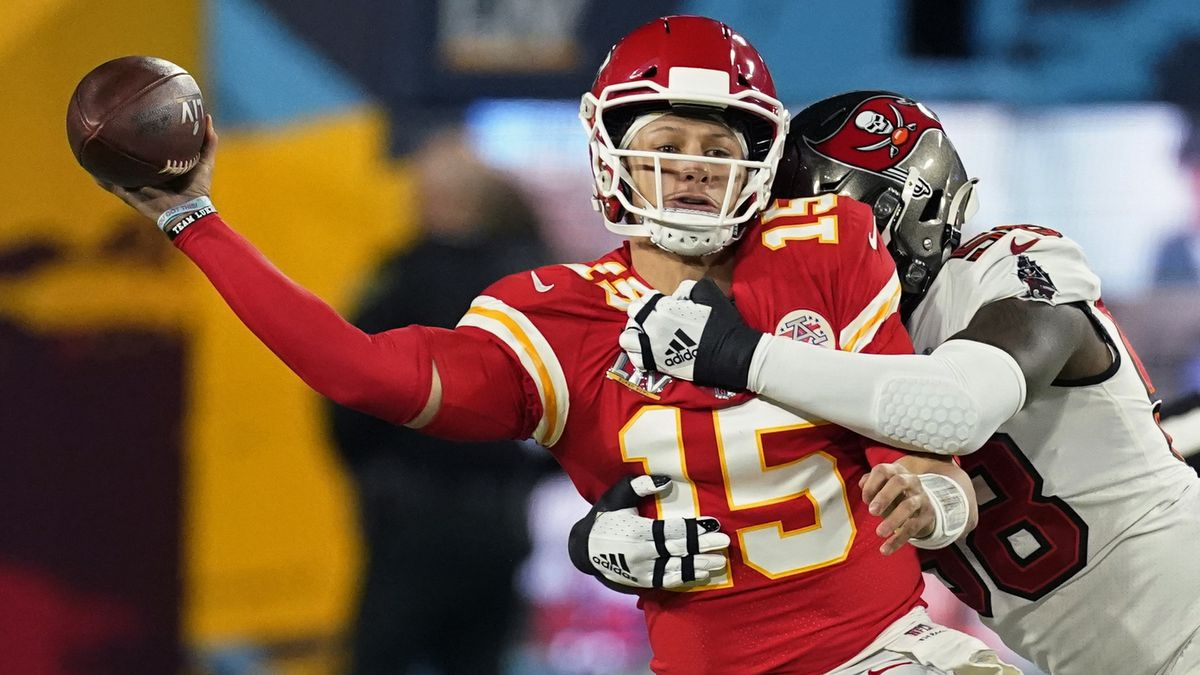 Kansas City Chiefs quarterback Patrick Mahomes passes under pressure from Tampa Bay Buccaneers...