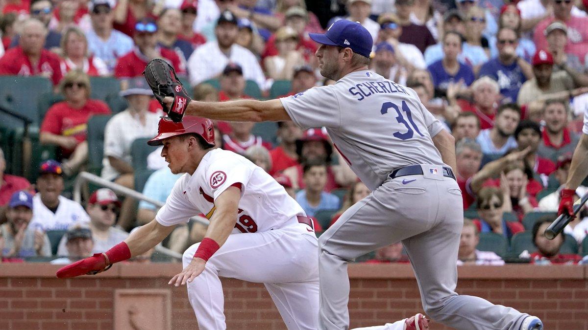 St. Louis Cardinals' Tommy Edman (19) scores past Los Angeles Dodgers starting pitcher Max...