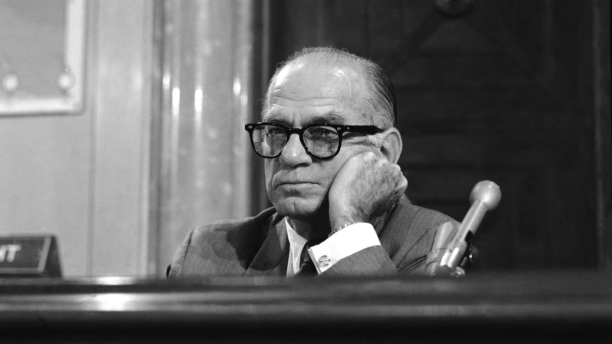 Senate Foreign Relations Committee Chairman J. William Fulbright, D-Ark listens as Secretary of...