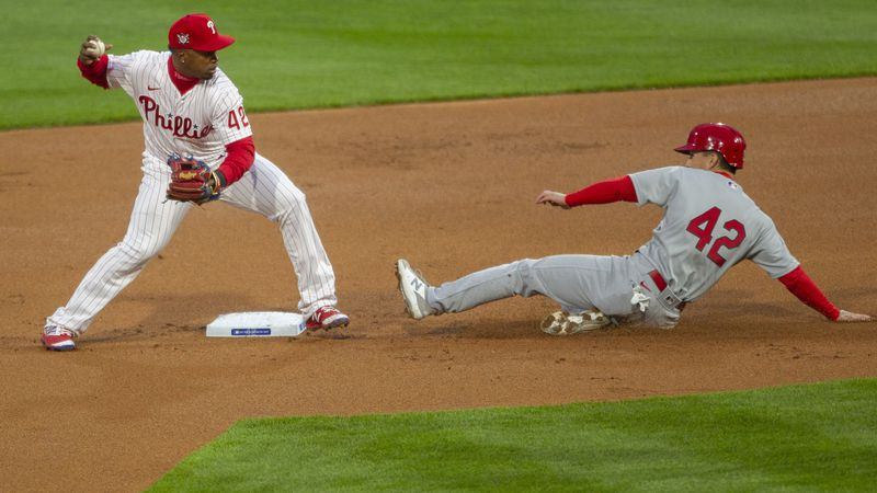St Louis Cardinals Tommy Edmann is out at second as Philadelphia Phillies second baseman Jean...