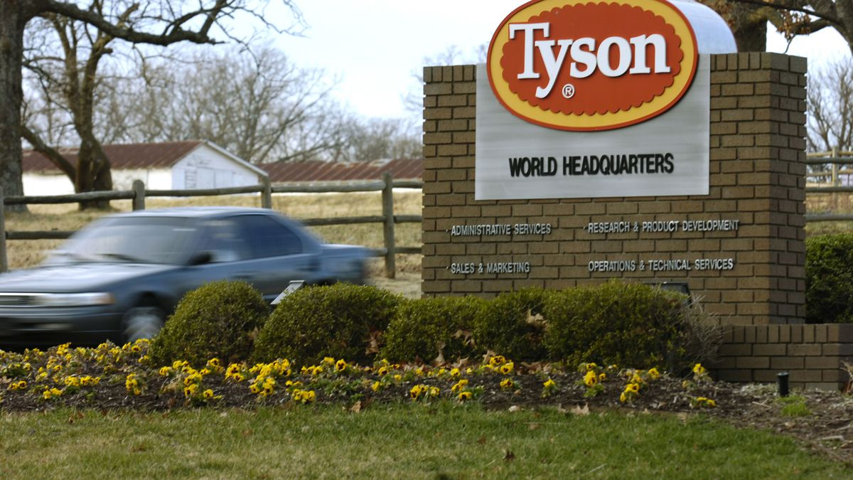 FILE - In this Jan. 29, 2006, file photo, a car passes in front of a Tyson Foods Inc., sign at Tyson headquarters in Springdale, Ark. China's decision to ban imports from a single Tyson Foods poultry plant because of concerns about a coronavirus outbreak there puzzled many in the meat industry and raised concerns about whether this could threaten a major market for U.S. meat. The action China's customs agency took against the Tyson plant in Springdale, Arkansas, could have major implications for the meat industry if it were expanded because dozens of beef, pork and poultry plants have had outbreaks of the coronavirus among their workers.(AP Photo/April L. Brown, File)