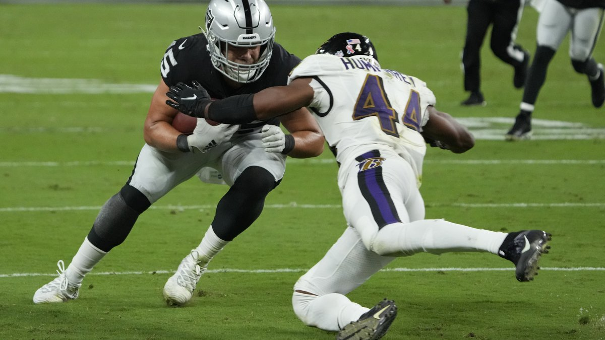 Baltimore Ravens cornerback Marlon Humphrey (44) tackles Las Vegas Raiders fullback Alec Ingold...