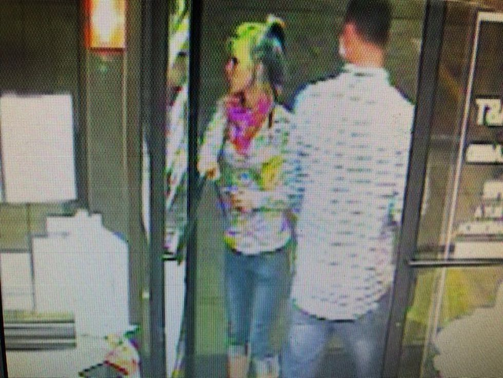 The woman and man tried to use the cards at a gas station less than a mile from the victim's home.