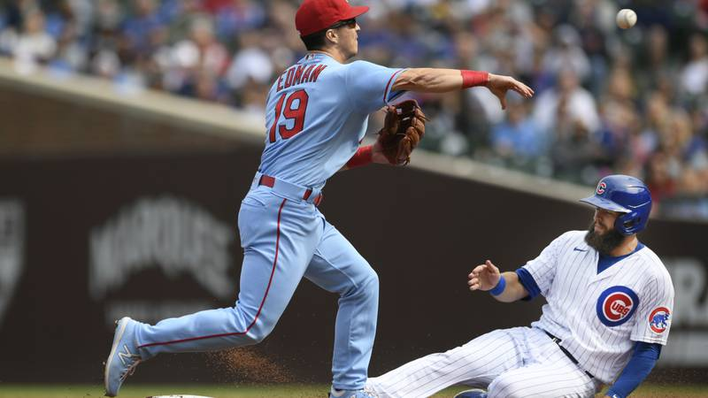 St. Louis Cardinals' second baseman Tommy Edman (19) forces out Chicago Cubs' David Bote at...