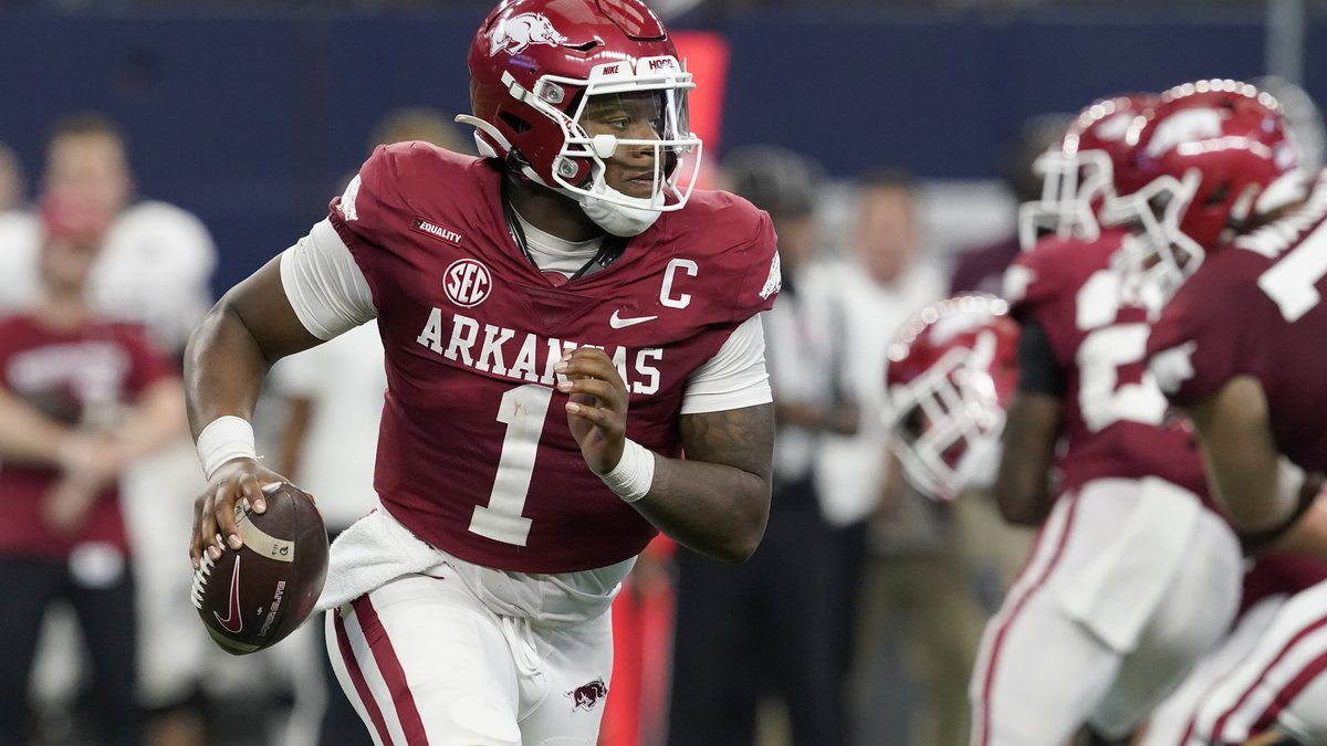 Arkansas quarterback KJ Jefferson scrambles out of the pocket before throwing a pass in the...