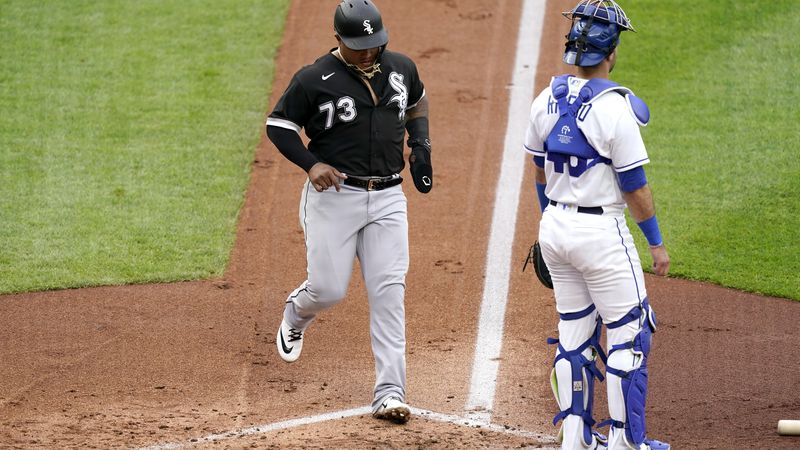 Chicago White Sox's Yermin Mercedes runs home to score past Kansas City Royals catcher...