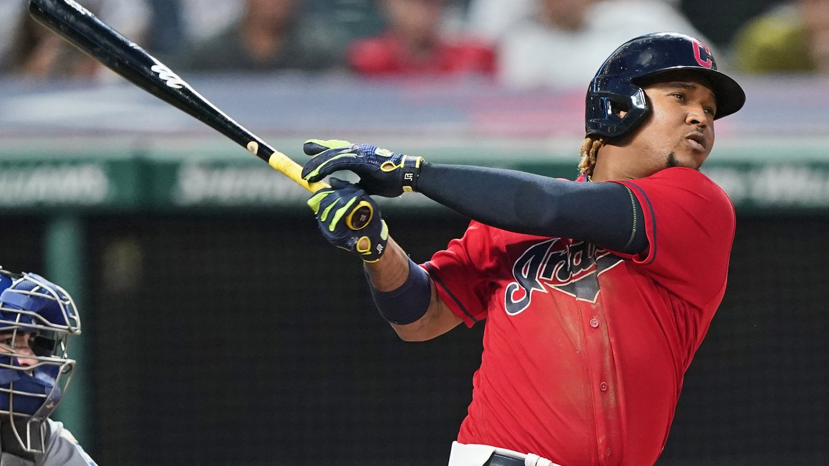 Cleveland Indians' Jose Ramirez watches his solo home run during the eighth inning of the...