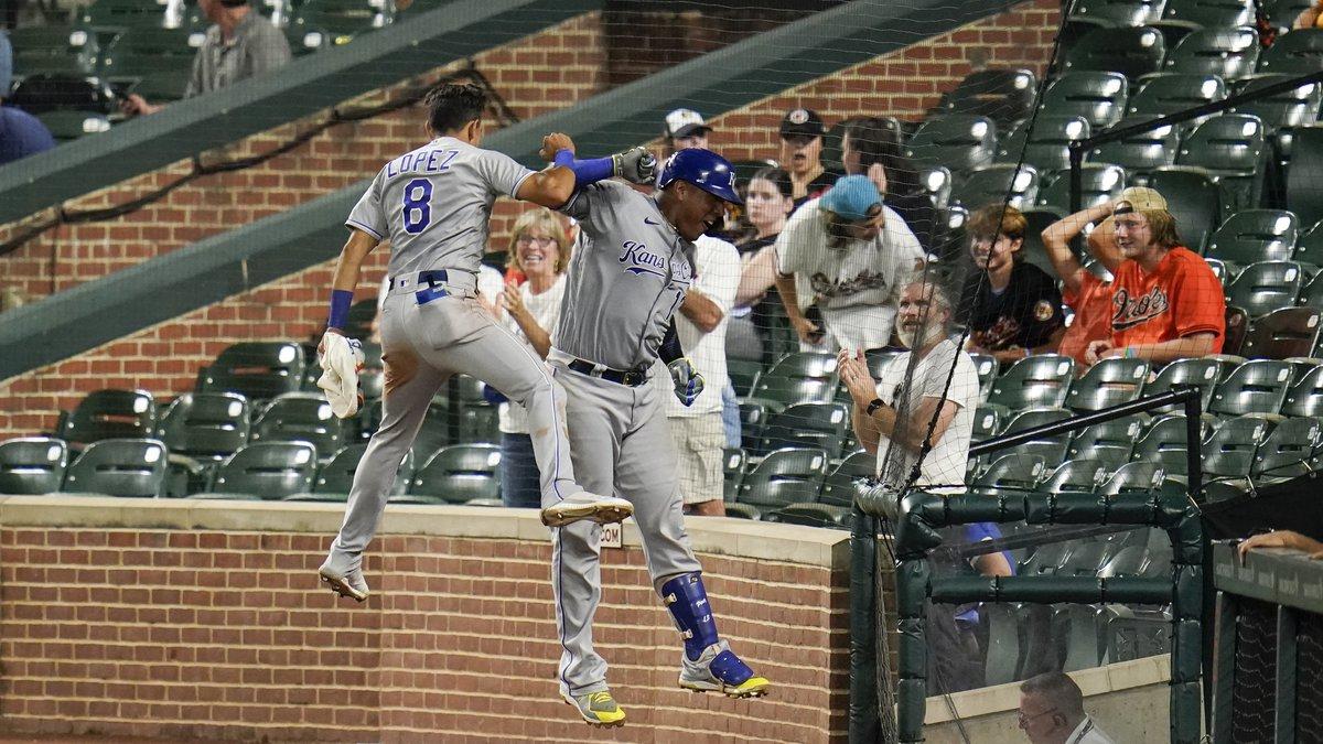 Kansas City Royals' Salvador Perez, right, celebrates his solo home run against the Baltimore...