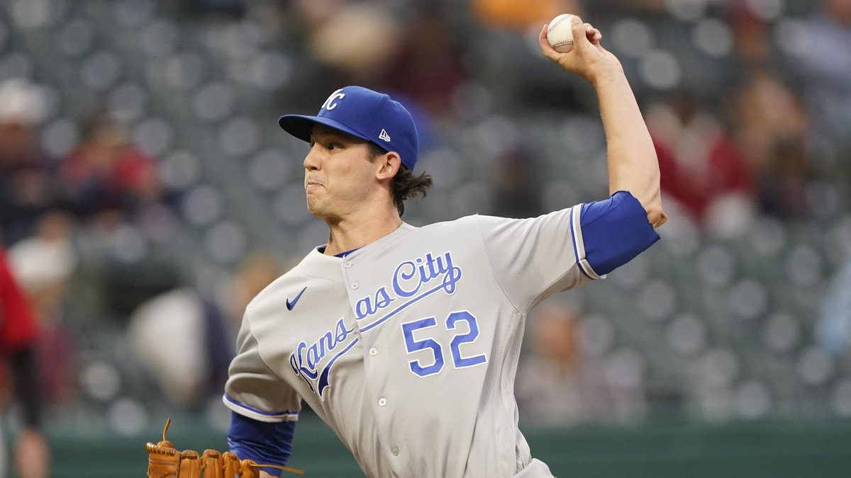 Kansas City Royals starting pitcher Daniel Lynch delivers in the first inning of a baseball...
