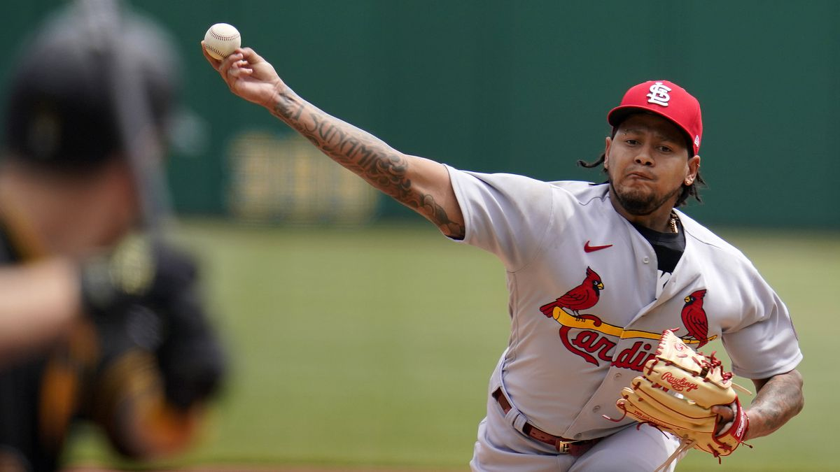 St. Louis Cardinals starting pitcher Carlos Martinez delivers during the first inning of a...