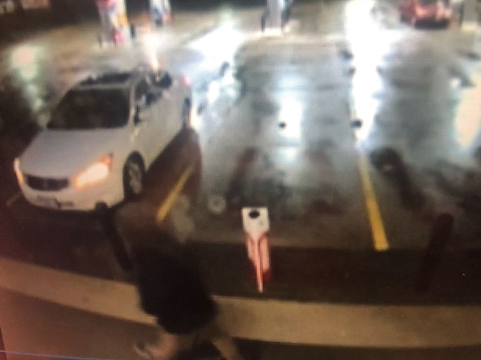 The man is seen getting into a white Honda (possibly an Accord) with a sunroof.