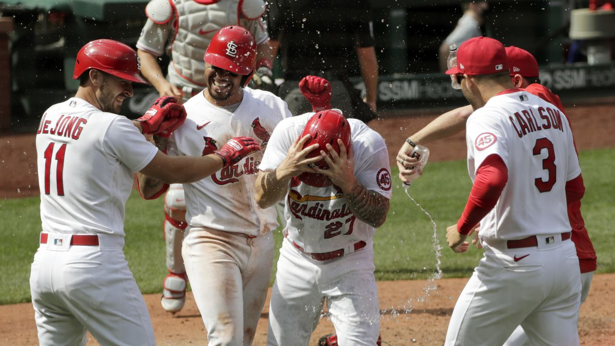 St. Louis Cardinals' Tyler O'Neill (27) celebrates with teammates Paul DeJong (11), Dylan...