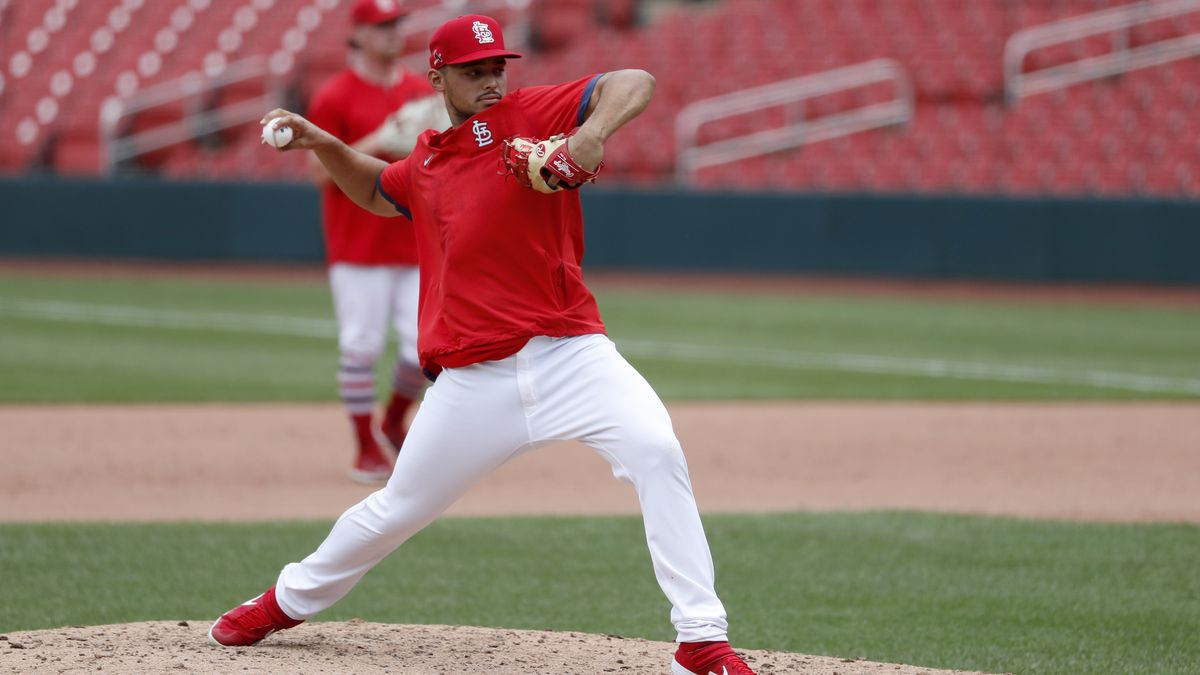 St. Louis Cardinals pitcher Jordan Hicks throws off the mound during baseball practice at Busch Stadium Friday, July 3, 2020, in St. Louis. (AP Photo/Jeff Roberson)