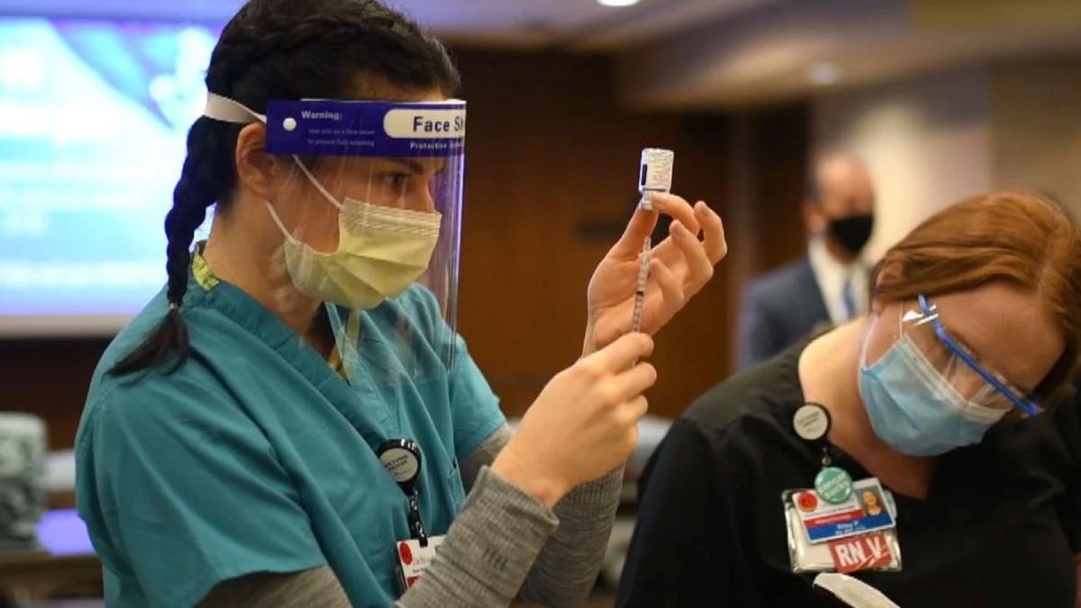 Nurse administers COVID-19 vaccine in Springfield, Mo.