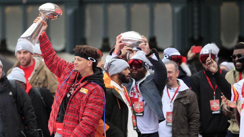 Kansas City Chiefs quarterback Patrick Mahomes holds the Vince Lombardi trophy during a Super...